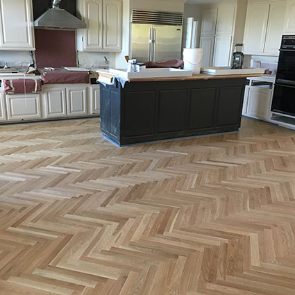 herringbone floor sanded in kitchen